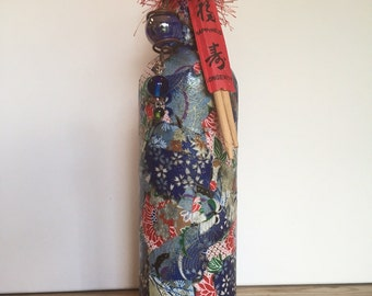 Asian inspired decoupaged bottle with chop sticks.
