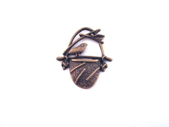 12 brass bird nest charms