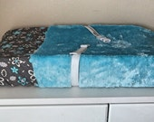Luxuriously soft changing pad cover in fuzzy blue luxe with gray, white, and blue floral cotton