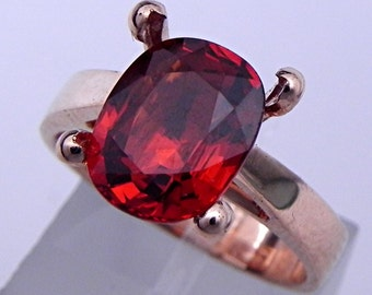 Red Hessonite Garnet   10.3x8.4mm  4.14 Carats   in a 14K Rose gold cathedral style engagement ring.  1929
