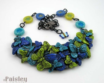 Blue Green Butterfly Bib Necklace, polymer clay collage and beads on matte black brass chain, adjustable length