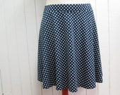 Semicircular skirt, short and flared skirt, white polka dots on navy blue, polyester and spandex jersey, elastic waistband, XS, S