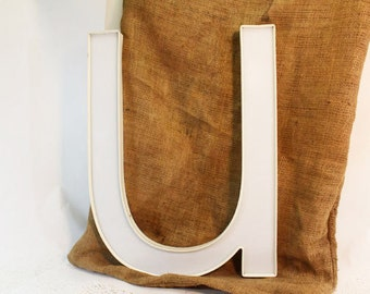 White Letter U, lower case 'U' in plastic