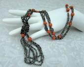 "Flapper Necklace with tassel - Black & orange glass beads - 18"" long - 1920s-30s Deco"