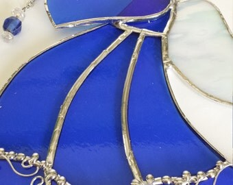 stained glass angel in royal blue with white angel wings and decorative solder