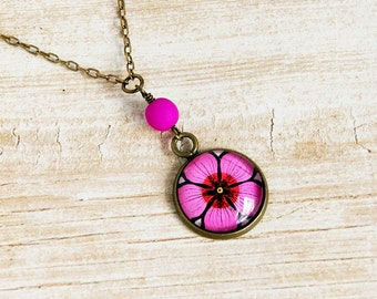 fuschia flower upcycled stamp pendant, cabochon pendant, recycled postage stamp, photo pendant, pink, hippie, boho