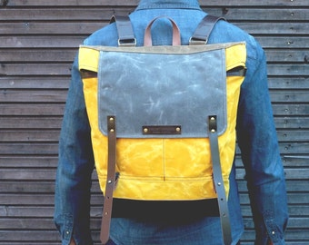 Waxed canvas backpack  / rucksack with folded top and  leather shoulderstrap and bottom