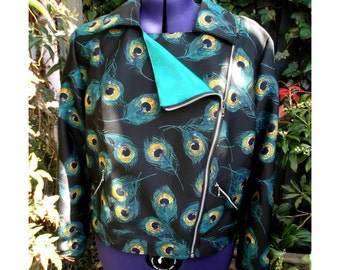 biker jacket in fabulous peacock feather print.  fully lined in green satin. metal zip details plus size