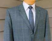 vintage 1960's -Curlee- Men's tweed sport coat. Trad styling...3/2 roll - Soft shoulder - Sack. Vibrant Prince of Wales plaid. 43 - 44 Reg.