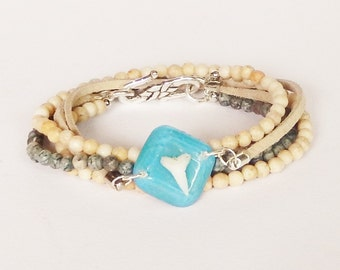 Double wrap Shark tooth bracelet with a real shark tooth set in clear resin with a blue background, Jasper beads and beige suede cord