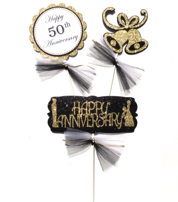 Black and gold glitter th anniversary themed centerpiece