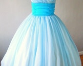 50s style V neck dress, light sky blue chiffon overlay with darker waistband, flattering for all sizes