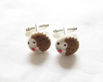 Hedgehog with red apple cufflinks or earrings. On beige or pink background. Donation to The British Hedgehog Preservation Society