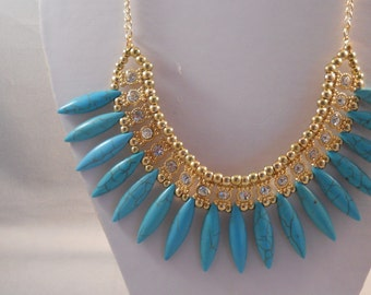 Gold Tone Bib Necklace with Turquoise Water Drop Pendant Beads and Clear Rhinestones on a Gold Tone Chain