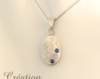 BALANCE * oval pendant with transparent and blue stones