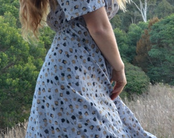Vintage powder blue chiffon librarian dress with retro autumn spring leaves.