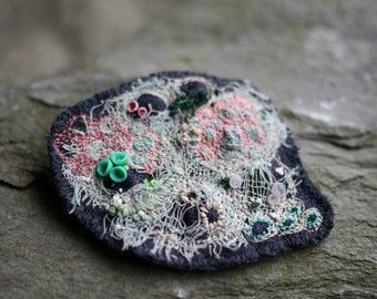 Coral and barnacle brooch, mixed media textile and clay