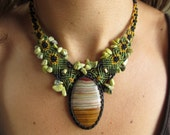Green Onyx Macrame Necklace handmade with natural Green Onyx gemstone cabochon and small serpentine stone beads