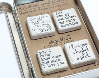SINGABLE Magnet Collection. Rustic Magnets. Concrete Magnets. Gift Tin. I love you a bushel and a peck. You are my sunshine.