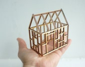 Small geometric bamboo house framework - 3D architectural line drawing - rustic wooden structure - little tabletop cabin