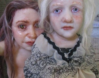 Two girls. Polymer clay sculpture