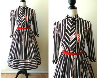 Amazing vintage black and white striped tea length dress with neck tie.
