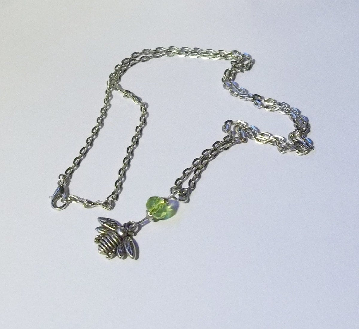 antique silver bumble bee pendant and peridot by