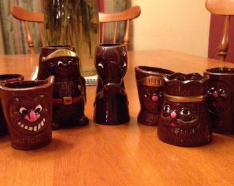 Set of Seven Novelty Brown Shot Glasses