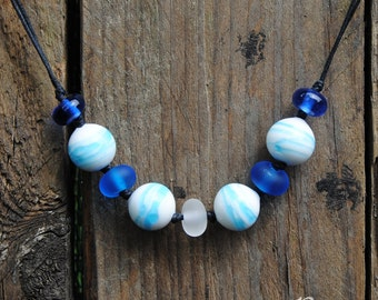Clouds: necklace with murano glass beads dark blue, white and transparent-lampwork