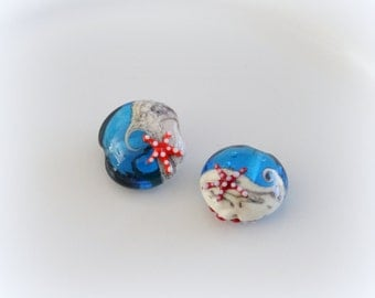 Blue  and ivory sea Handmade Glass Bead with starfish on both sides.