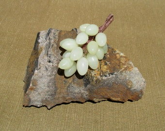 Juicy bunch of gemstone grapes, 1970s