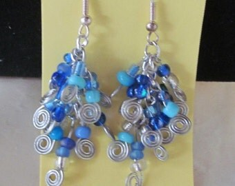 Item #: ER3002 - Sky Blue dangle beaded earrings.