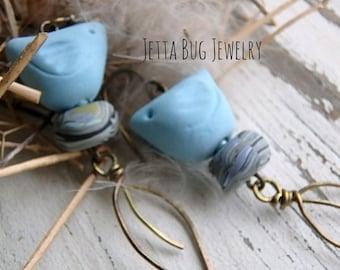 Blue Skies- matte sky blue ceramic birds. polymer nest beads. brass leaves. rustic blue bird earrings. bohemian nature. Jettabugjewelry