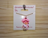 "Strawberry shortcake vintage 1981 plastic necklace on a 16"" fine gold plated chain in Dream House Metal Box"