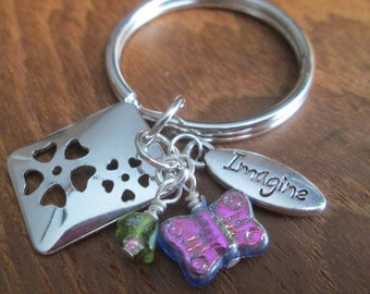 "handmade ""imagine"" beaded keychain"