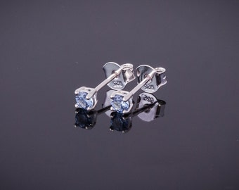 Few studs with round topaz blue 3.0 mm, Silver 925