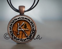 The Dark Tower KA Pendant in Copper or Gun Metal Black with Leather Cord Two Design Choices