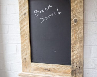 Chalkboard made from reclaimed pallet wood with chalk shelf.