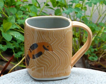 Porcelain gold finch mug