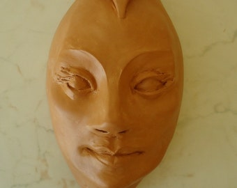 "Ceramic wall mask Wall hanging artwork Pottery decorative masks Face for the wall Wall sculpture ""A message from beyond"". Clay wall art."