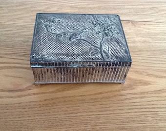 Vintage metal tin with bird detail