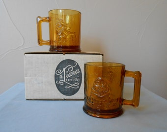 """TIARA Exclusive Indiana Glass """"Little Ones"""" Line #10041, 1970 Amber Glass Nursery Rhymes Mugs 2 - Humpty Dumpty and Tom Tom The Piper's Son"""