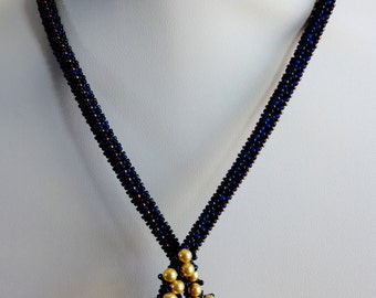 Royal blue beaded necklace with lushes of golden Swarovski pearls
