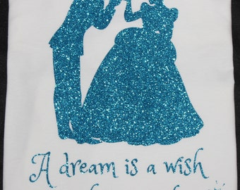 """Disney's Cinderella and Prince Charming """"A dream is a wish your heart makes."""" (Glitter) T-shirt"""
