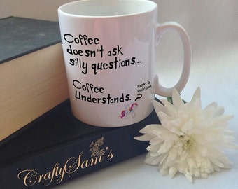 Coffee doesn't ask questions mug