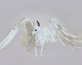 The figure of the wolf,white wolf,winged wolf,blue eyes,wolf figurine,wolf sculpture,figurine wolf