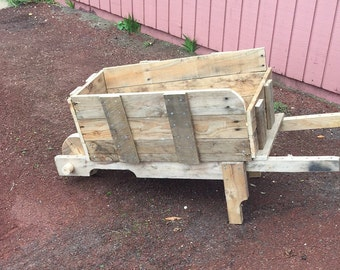Bespoke wheel barrow made from reclaimed wood