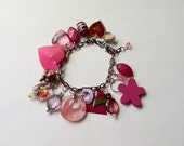 Repurposed Vintage Shades of Pink Earrings and Charms on Bracelet