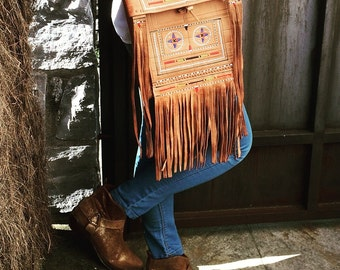 Leather fringed bag.