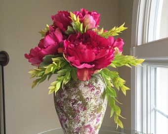 Fushia peonies with spring greens in colorful vase